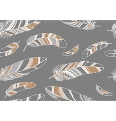 Seamless pattern with beige feathers on a gray vector image