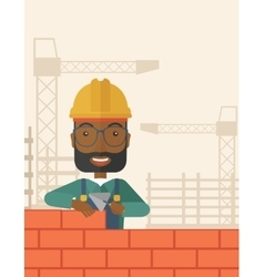 Black builder man is building a brick wall vector