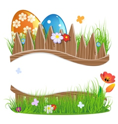 Painted easter eggs with grass and flowers vector