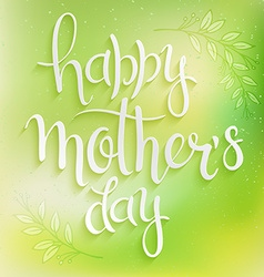Hand drawn mothers day lettering on a green blur vector