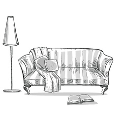 Comfortable sofa and a lamp vector