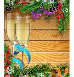 Glasses of champagne and christmas tree branches vector