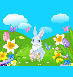 Easter bunny with a basket full of easter eggs vector