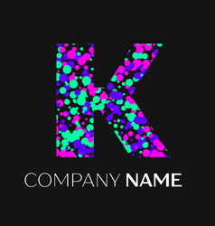 letter k logo with pink purple green particles vector image
