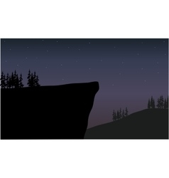 silhouette of cliff at night scenery vector image