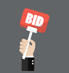 hand holding auction paddle vector image