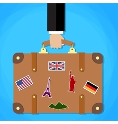 Briefcase with stickers in hand vector