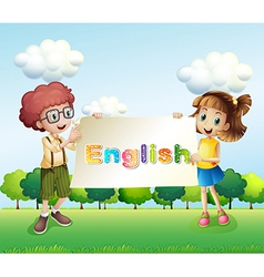 A boy and a girl holding a banner vector image vector image