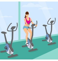 Young woman uses a bicycle in the gym for a good vector