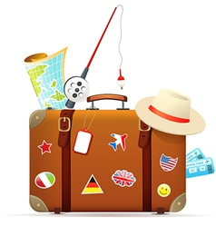 Old travel suitcase with traveling accessories vector