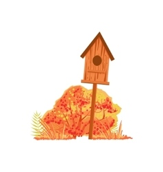 Bird house and bush with orange leaves as autumn vector