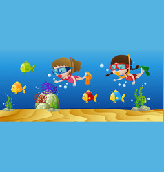 two girls diving under the ocean vector image