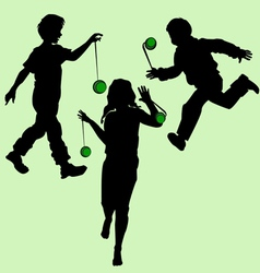 Silhouettes of children playing vector
