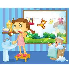 A child brushing her teeth vector image vector image