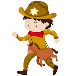 Boy in cowboy costume vector
