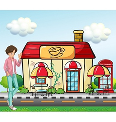 A boy standing in front of the coffee shop vector image vector image