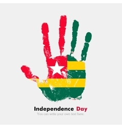 Handprint with the flag of togo in grunge style vector