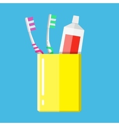 Toothbrush toothpaste in a glass vector image