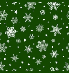 Seamless pattern of snowflakes white on green vector