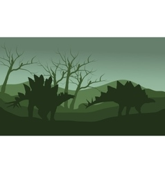 Silhouette of stegosaurus in hills vector