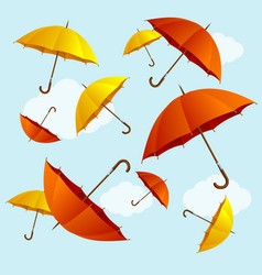 umbrellas fall on blue sky background flat design vector image