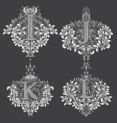 Set of ornamental monogram in coats of arms form vector