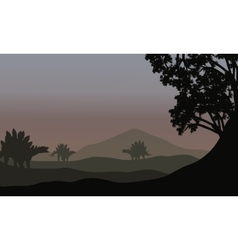 Silhouette of stegosaurus in fields vector