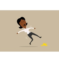 Businesswoman slipped on a banana peel vector