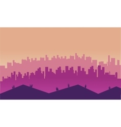 City and hills scenery at afternoon silhouettes vector