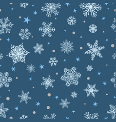 Seamless pattern of snowflakes white on blue vector
