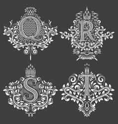 set of heraldic monograms in coats of arms form vector image vector image