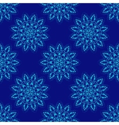 Seamless mandala pattern over blue vector