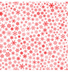Seamless pattern of snowflakes red on white vector