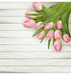 Pink tulips over white wood table EPS 10 vector image