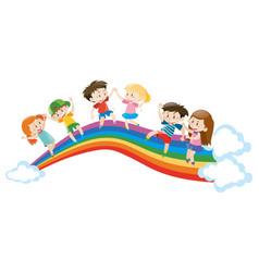 Children dancing on rainbow vector