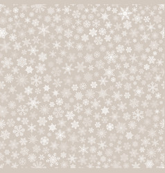 Seamless pattern of snowflakes white on beige vector