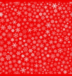Seamless pattern of snowflakes white on red vector
