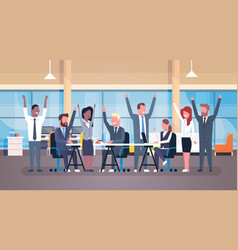 cheerful business team sitting together at desk vector image vector image