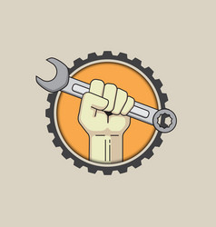Fist with wrench on gear background vector