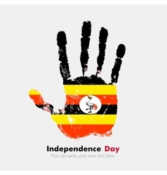 Handprint with the flag of uganda in grunge style vector