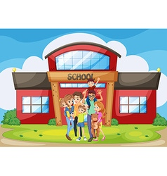 Family standing in front of school building vector