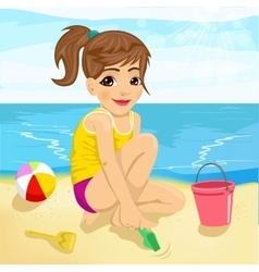 Cute little girl playing with sand on beach vector