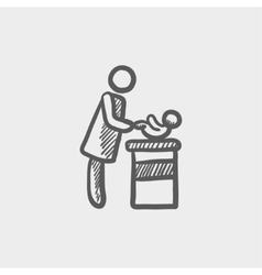 Woman changing the babys diaper sketch icon vector