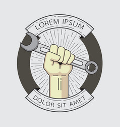 Fist with wrench badge vector