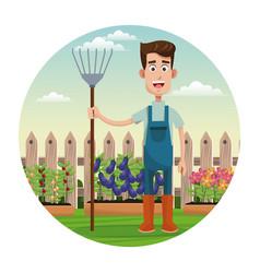 Cute farmer coveralls and pitchfork garden fence vector