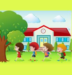 Four kids going to school vector