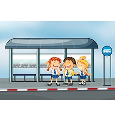 Students at the bus stop vector image