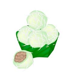 Thai Stuffed Coconut Ball in Counts Banana Leaf vector image vector image