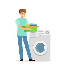 Young smiling man doing laundry holding basin vector
