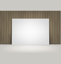 Blank white poster frame on floor with wooden wall vector